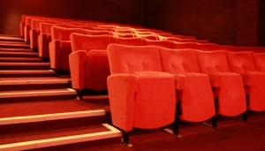 Red fold up seats in the Little Theatre