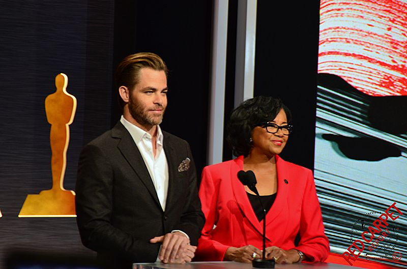 Academy president, Cheryl Boone Isaacs, and actor Chris Pine announcing this year's Oscar nominations. © Red Carpet Report. Original via Flickr/ Creative Commons Attribution Licence