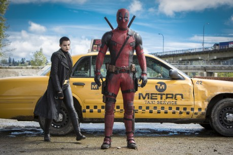 Having enjoyed a leisurely cab drive, Deadpool (Ryan Reynolds) is ready for battle, joined by Negasonic Teenage Warhead (Brianna Hildebrand).